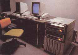 Photo 1: Two of the Xerox Alto personal computers. Each Alto processor is made of medium- and small-scale TTL integrated circuits, and is mounted in a rack beneath two 3-megabyte hard-disk drives. Note that the video displays are taller than they are wide and are similar to a page of paper, rather than standard television screen.